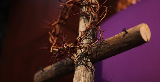 A Lenten display- crown of thorns and cross with purple cloth herald the beginning of Lent. Photo by Kathleen Barry, UMNS. Accompanies story #133. 3/3/2010.